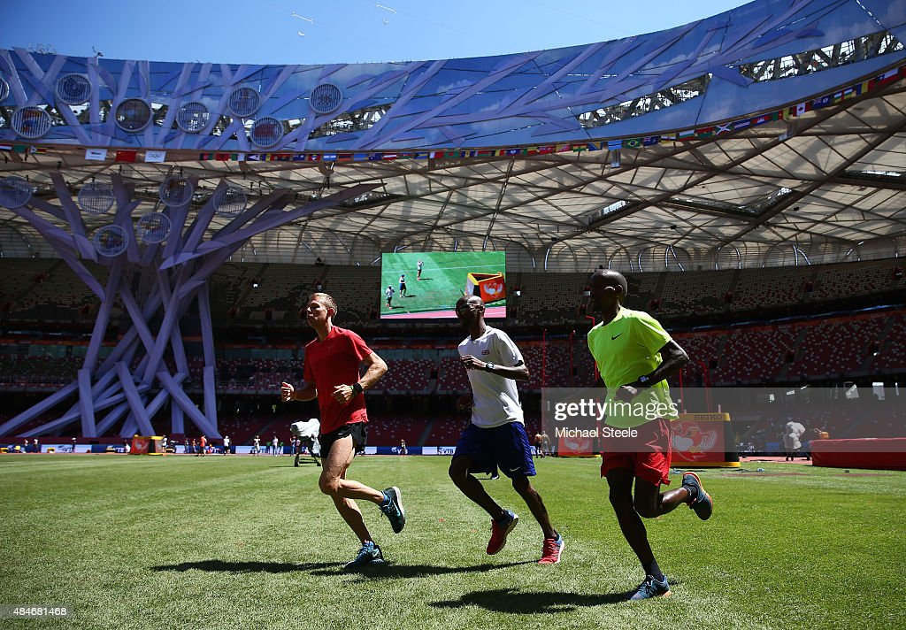 Galen Rupp of the United States, Mo Farah of Great Britain and Belgian athlete Bashir Abdi during a practice session ahead of the 15th IAAF World Athletics Championships Beijing 2015 at the Beijing National Stadium on August 21, 2015 in Beijing, China.