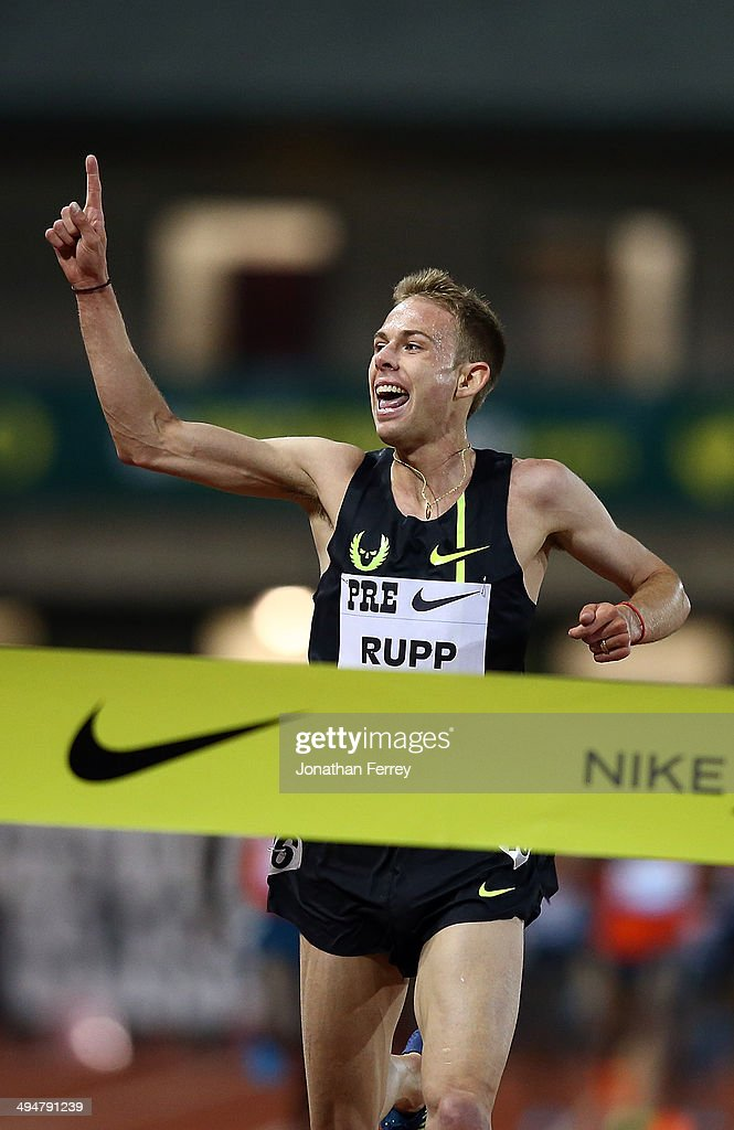 Galen Rupp of USA celebrates setting an American record of 26:44:36 after winning the 10,000m during day 1 of the IAAF Diamond League Nike Prefontaine Classic on May 30, 2014 at the Hayward Field in Eugene, Oregon.