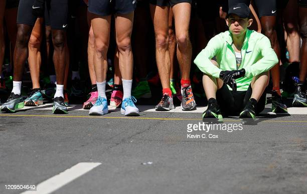 Galen Rupp sits at the start line as they wait for the start of the U.S. Olympic marathon team trials on February 29, 2020 in Atlanta, Georgia.