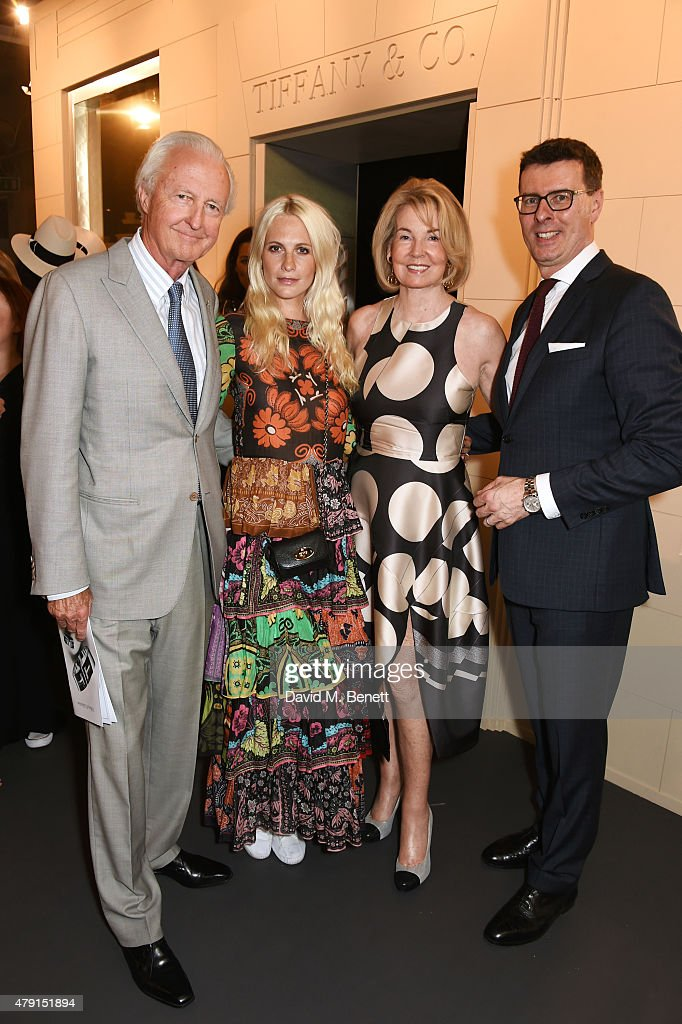 Galen Weston, Poppy Delevingne, Hilary Weston and Barratt West, Tiffany & Co VP and Managing Director, UK and Ireland, attend the Tiffany & Co. immersive exhibition 'Fifth & 57th' at The Old Selfridges Hotel on July 1, 2015 in London, England.