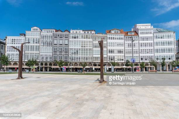 galerias (glass-fronted balconies) on marina avenue in a coruna city - a coruña stockfoto's en -beelden