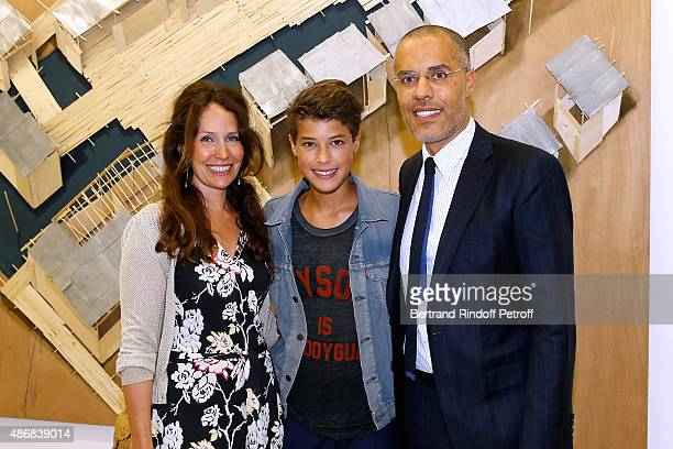 Galerist Kamel Mennour with his wife Annika and their son Kayen attend the 'Heroes Exhibition' to Benefit Imagine Association Cocktail Party Held at...