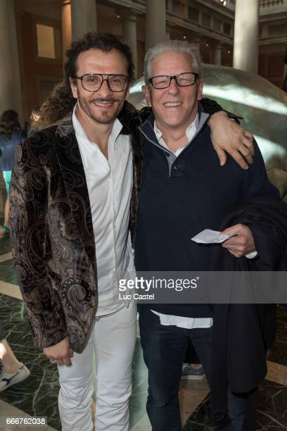 Galerist Lorenzo Fiaschi and Jan Fabre attend the opening of Damien Hirst 'Treasures From The Wreck Of The Unbelievable' new exhibition on April 8...