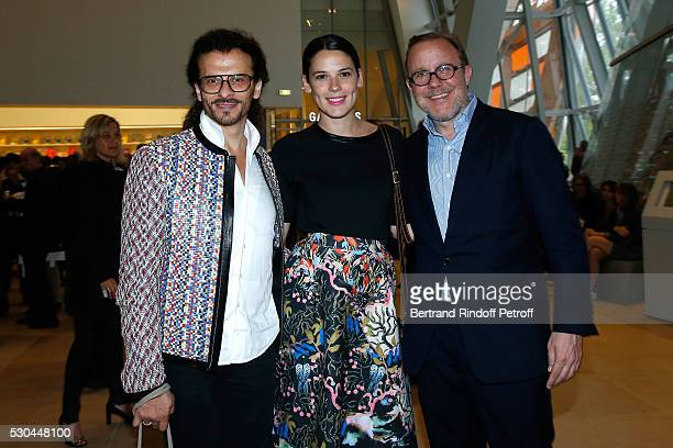 "Galerist Lorenzo Fiaschi, Laura Salas Redondo and galerist Xavier Hufkens attend the ""Observatory of Light, Work in Situ"" : Foundation Louis Vuitton..."