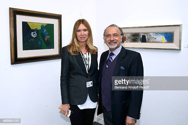 Galerist Sophie Sheidecker and Olivier Dassault pose in Sophie's Gallery during the 'FIAC 2015 International Contemporary Art Fair' at Le Grand...