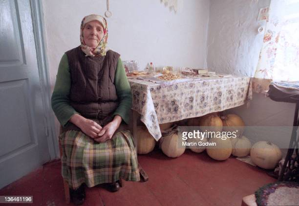 Galiana Ivanovna aged 72 who returned to live in the town of Apachichis inside the 30km Chernobyl exclusion zone inside her house with pumpkin seeds...