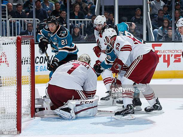 Galiardi and Ryane Clowe of the San Jose Sharks try to score against Jason LaBarbera Derek Morris and Keith Yandle of the Phoenix Coyotes during an...