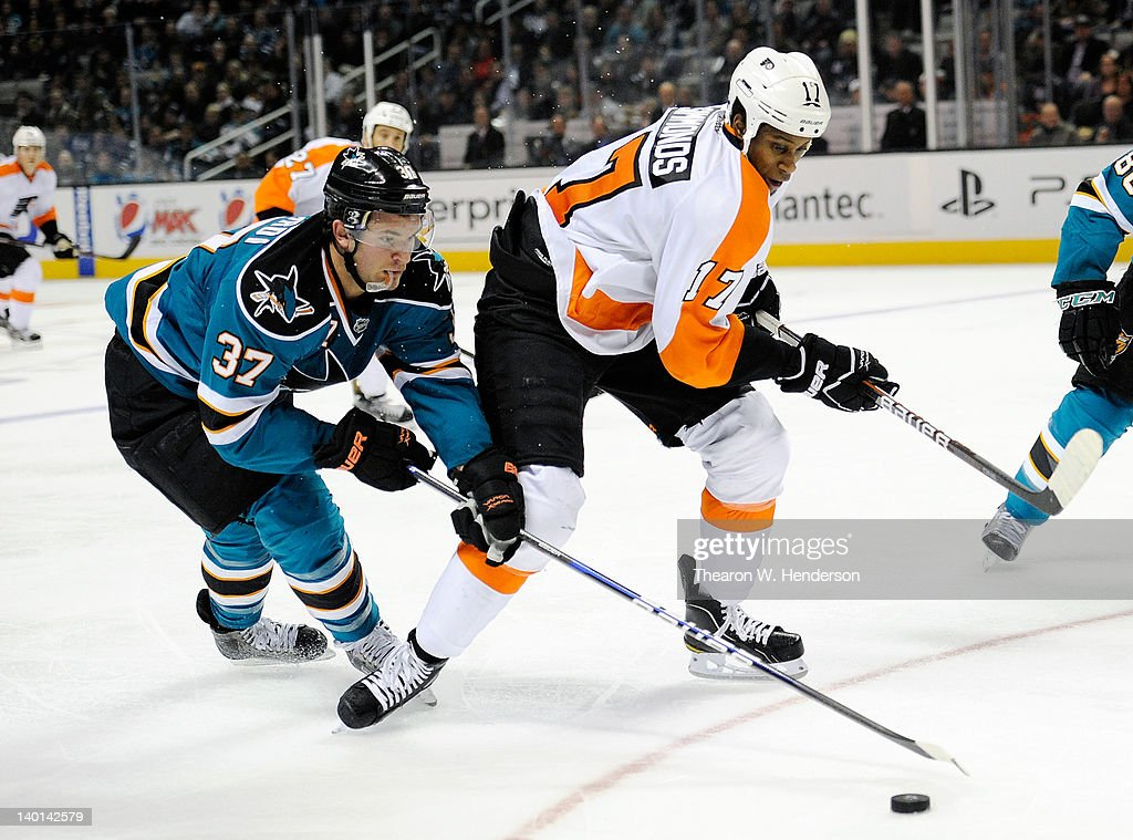 TJ Galiardi #37 of the San Jose Sharks looks to gain control of the puck away from Wayne Simmonds #17 of the Philadelphia Flyers at HP Pavilion at San Jose on February 28, 2012 in San Jose, California. The Sharks won the game 1-0.