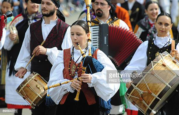 Galician musicians of the 'Grupo de danza Xacarandaina' parade playing bagpipes on August 2 2009 in Lorient western France during the celtics nations...