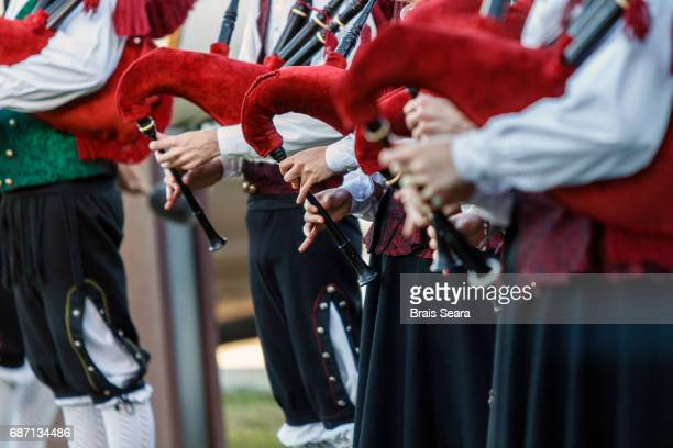 galician piper group - traditional musician stock photos and pictures