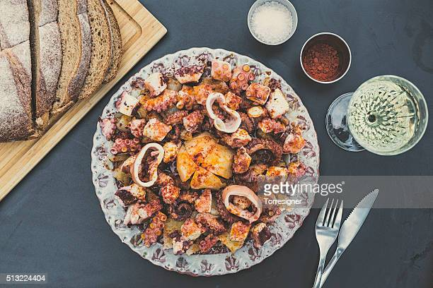 galician-style octopus - spanish culture stock photos and pictures