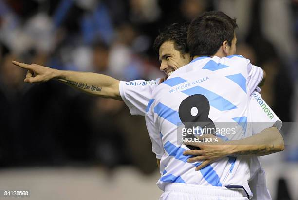 Galicia's Nacho Novo celebrates with teammate Dani Abalo after scoring against Iran during their friendly football match at the Riazor Stadium in...