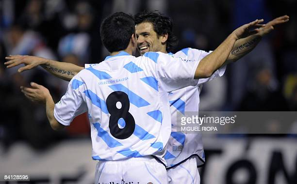 Galicia's player Nacho Novo celebrates with teammate Dani Abalo after scoring a goal against Iran during their friendly football match at the Riazor...