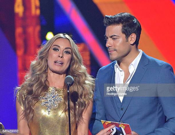 Galilea Montijo and Carlos Rivera speak onstage at the Univision's 13th Edition Of Premios Juventud Youth Awards at Bank United Center on July 14...