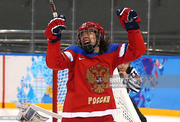 Galina Skiba of Russia celebrates after scoring a goal in the second period against Nana Fujimoto of Japan during the Women's Ice Hockey...