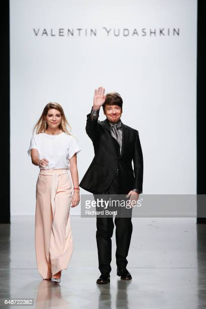 Galina Yudashkina and designer Valentin Yudashkin walk the runway during the Valentin Yudashkin show at Palais de Tokyo during Paris Fashion Week...