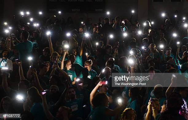 Gallaudet University students faculty and staff use their phones as a light source as the power temporarily went out during a rally and protest...