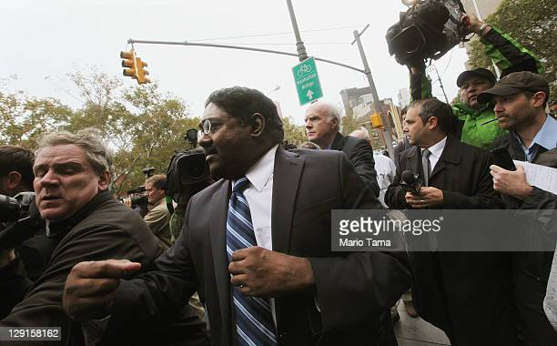 Galleon Group founder Raj Rajaratnam jostles with photographers while exiting Manhattan Federal Court after a sentencing hearing on October 13 2011...