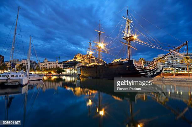 A galleon in Alicante Spain reflected in the port
