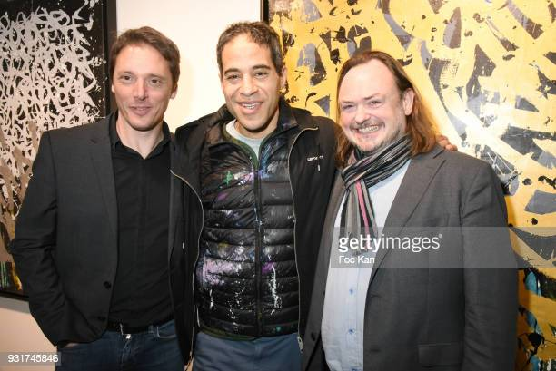 Gallerist Laurent Rigail painter JonOne and Eric Brugier attend ÔÔBirth of The WindÕ JonOne PreviewÊÈ at Galerie Brugier Rigail on March 13 2018 in...