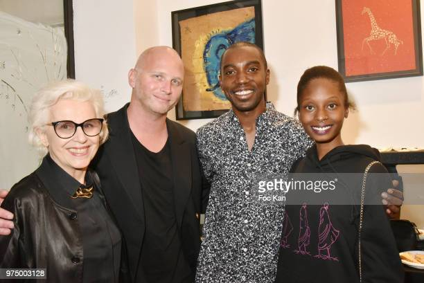 Gallerists Christine Laaban and her son Romain Battaglia from Galerie La Cle Roxane Depardieu agent Seraphin Agbodo and Chantelle Broomes attend...