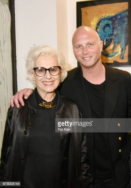 Gallerists Christine Laaban and her son Romain Battaglia from Galerie La Cle attend 'Kingdom Animalia' Roxane Depardieu Paintings Exhibition Preview...