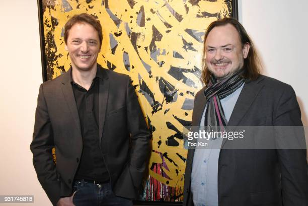Gallerists Laurent Rigail and Eric Brugier attend ÔÔBirth of The WindÕ JonOne PreviewÊÈ at Galerie Brugier Rigail on March 13 2018 in Paris France