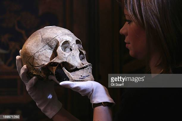 A gallery assistant at Bonhams auction house holds an engraved human skull which is expected to fetch 900 GBP in their forthcoming 'Gentleman's...