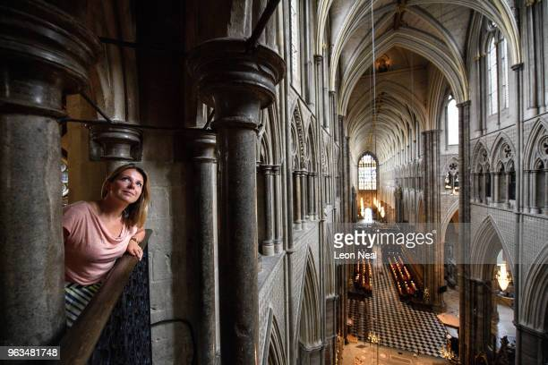 A gallery assistant poses as she looks from the Queen's Diamond Jubilee gallery at Westminster Abbey on May 29 2018 in London England The gallery...