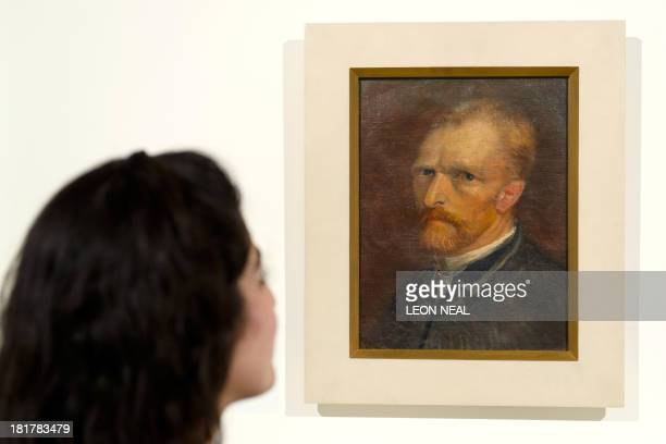 A gallery assistant poses with Vincent van Gogh Selfportrait during a preview viewing of the 'Van Gogh in Paris' exhibition at the Eykyn Maclean...