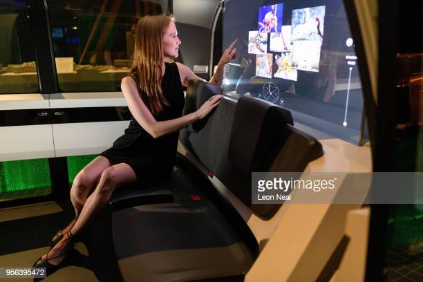 A gallery assistant sits inside the Sedric Volkswagen driverless concept car during the press launch of the new exhibition The Future Starts Here at...