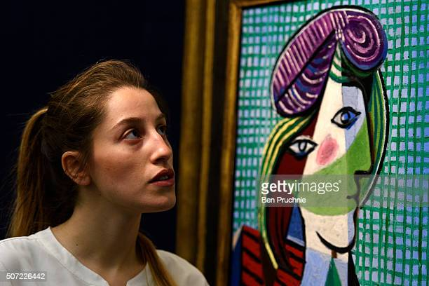 A gallery assistant views Tete De Femme by Pablo Picasso which is up for auction for an estimated GBP 16000 to 20000 at Sotheby's on January 28 2016...