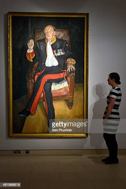 A gallery assistant views 'The Brigadier' by artist Lucian Freud during the preview ahead of Christie's New York post war and contemporary art sale...