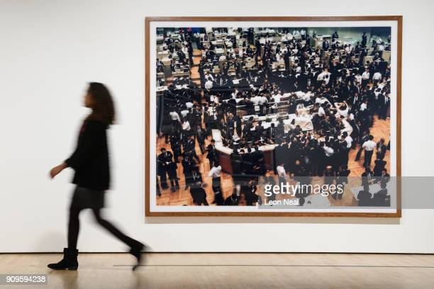 A gallery assistant walks past 'Tokyo Stock Exchange' by Andreas Gursky in the reopened Hayward Gallery on January 24 2018 in London England...