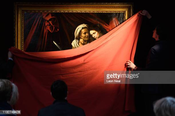 Gallery assistants reveal Judith and Holofernes by Caravaggio during a press event to promote the upcoming sale of the work at auction on February 28...