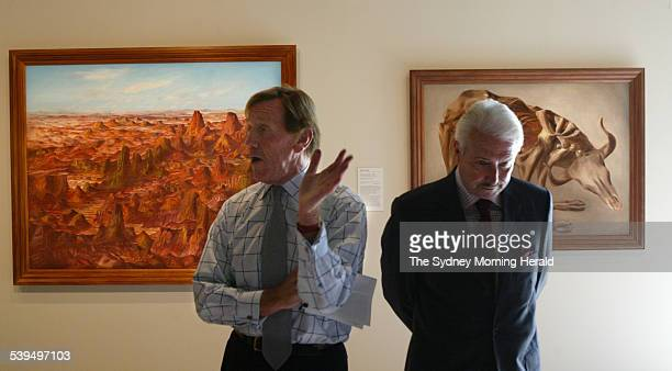Gallery director Edmund Capon and Nelson Meers with the paintings Central Australia 1950 and Drought Skeleton 1953 both by Australian artist Sidney...