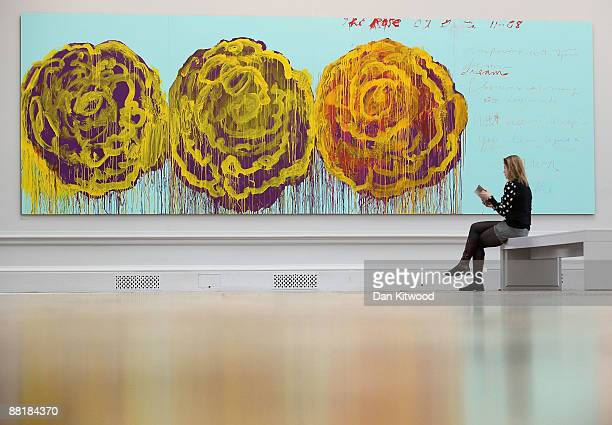 A gallery employee looks at a piece of work entitled The Rose III by artist Cy Twombly at the Royal Academy of Arts on June 3 2009 in London England...