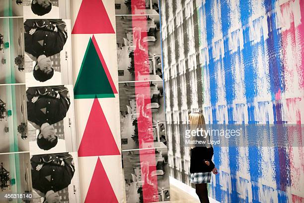 A gallery employee looks at Ciara Phillips' Things Shared 2014 at Tate Britain on September 29 2014 in London England The installation is from one of...
