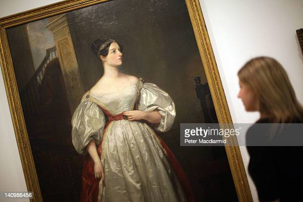 A gallery employee looks at Margaret Carpenter's painting 'Ada Lovelace Mathematician daughter of Lord Byron 1836' at The Whitechapel Gallery...