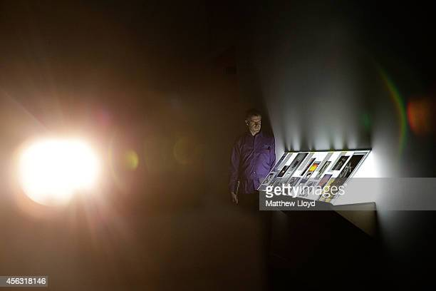 A gallery employee looks at Tris VonnaMichell's Addendum 1 Finding Chopin Dans L'Essex at Tate Britain on September 29 2014 in London England The...