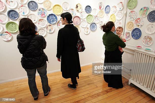 Gallery goers attend the A Piece of Fulvimari opening reception for artist Jeffrey Fulvimari at Gallery Hanahou on January 11 2006 in New York City