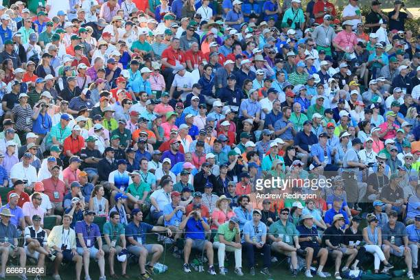 A gallery of patrons watch play on the 15th green during the final round of the 2017 Masters Tournament at Augusta National Golf Club on April 9 2017...