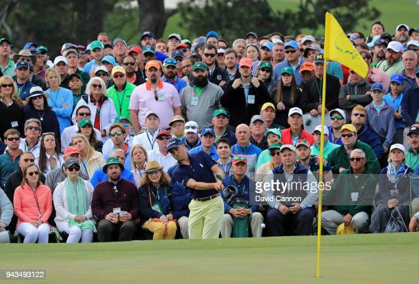 A gallery of patrons watch play on the 18th green during the final round of the 2018 Masters Tournament at Augusta National Golf Club on April 8 2018...