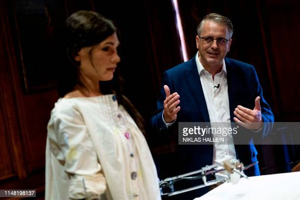 Gallery owner and creator of AiDa the AI humanoid robot artist Aidan Meller speaks during a press conference during a demonstration at a launch event...
