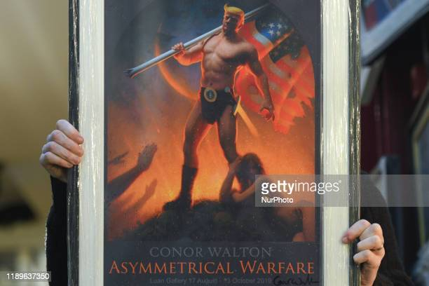 Gallery owner Frank O'Dea holds a framed digital print of the US President Donald Trump 'Novus Ordo Seclorum' , by artist Conor Walton, seen at Balla...