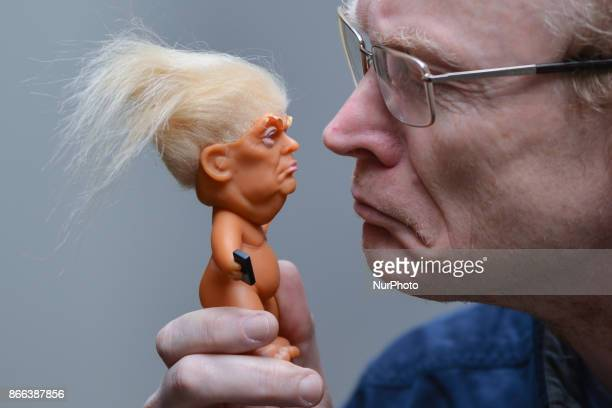 Gallery owner Frank O'Dea with a vinyl doll which features President Donald Trump made by a former sculptor for Disney Chuck Williams Troll dolls can...