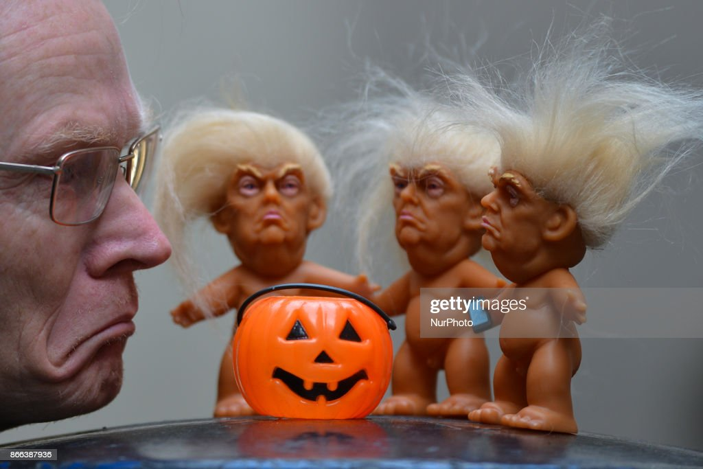 Gallery owner Frank O'Dea with three vinyl dolls which feature President Donald Trump, made by a former sculptor for Disney, Chuck Williams. Donald Trump Troll dolls can be seen and bought at Balla Ban Art Gallery in Dublin city center, ahead of Halloween. On Wednesday, 24 October 2017, in Dublin, Ireland.