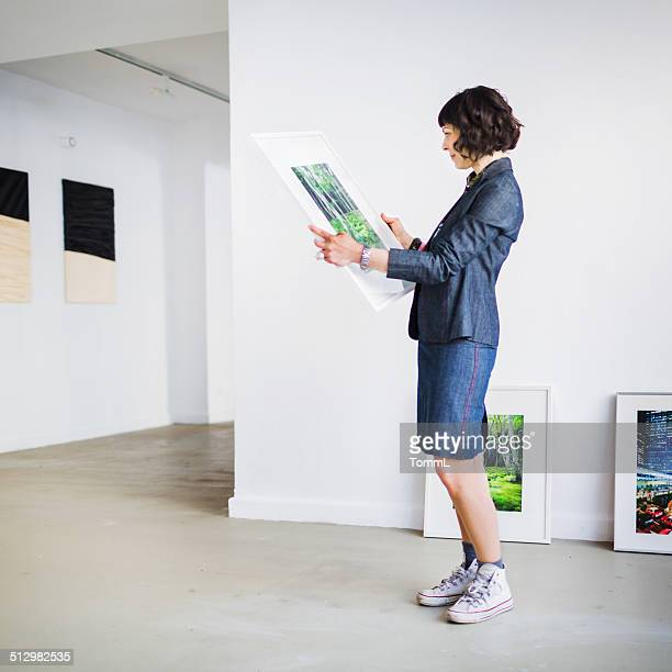 Gallery Owner Inspecting Picture
