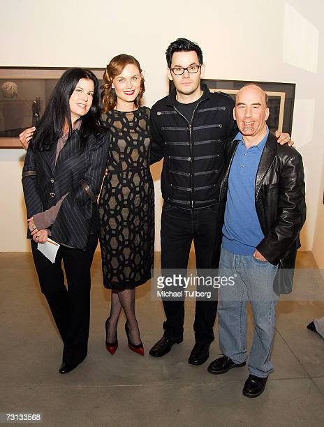 Gallery owner Jan Corey Helford actress Emily Deschanel artist Chris Anthony and gallery owner Bruce Helford attend the opening of the Chris Anthony...