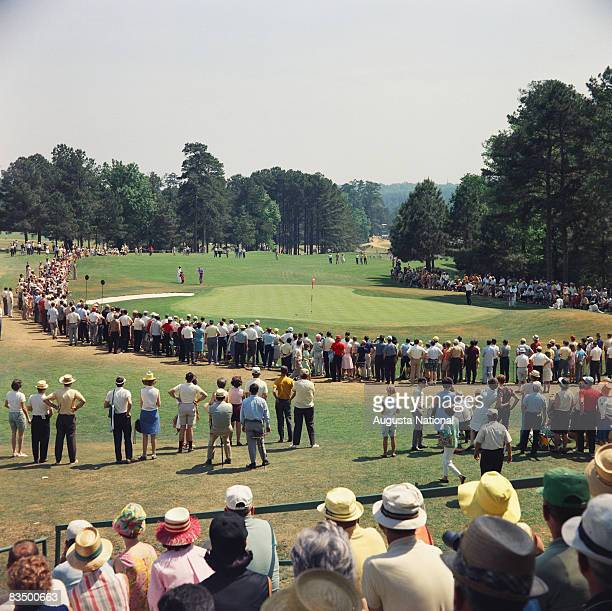 A gallery surrounds the eighth green during the 1967 Masters Tournament at Augusta National Golf Club in April 1967 in Augusta Georgia